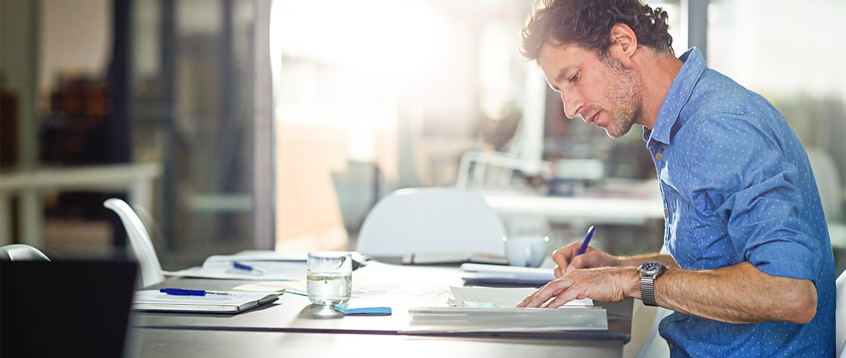 man doing paperwork image